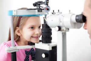 Young girl patient is having a medical attendance at the optometrist.